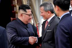 [<!HS>서소문사진관<!HE>] 김정은 위원장<!HS>,<!HE> 철저한 보안 속 싱가포르에 도착