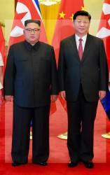 [서소문사진관]김정은 중국 갈 때도 키높이? 진짜 키는?