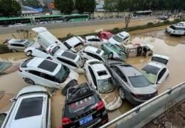 폭우가 삼켰던 中터널···물 빼보니 차 수백대 뒤엉켜있었다