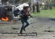 """""""피 흘리는 아이를 보고 무작정 뛰었다""""…테러 현장서 카메라 두고 구조에 나선 시리아 사진기자"""
