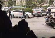 '음란물 유포' 로이킴 경찰 출석…취재진 질문에는 묵묵부답