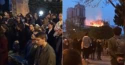 무너지는 노트르담 대성당 보며 기도하는 파리 시민들