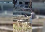 [단독]13층 기어올라간 러시아 北노동자, 생명줄은 안전모 뿐이었다