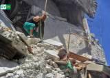 추락 7개월 동생 붙잡은 5살 언니의 사투, 시리아 공습이 부른 비극
