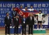 북한의 두얼굴…<!HS>축구<!HE>는 깜깜이, 역도는 과시