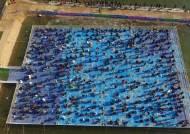 [서소문사진관] 플라스틱 부교에서 송어 낚시를, 추위 실종된 겨울축제 풍경
