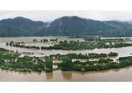 600㎜ 집중호우에 소양강댐 방류… 자라섬이 사라졌다