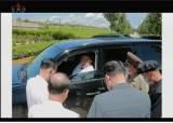 김정은의 '렉서스 리더십'…SUV 직접 몰고 수해지역 살폈다