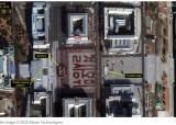 위성사진에도 찍힌 붉은글씨 '결사옹위'…김일성광장은 지금