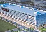 [분양포커스] 첨단 시설 갖춘 중고차 멀티 쇼핑몰축구장 15개 규모 현대식 건물 외관
