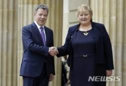 산토스 콜롬비아 대통령과 솔베르그 노르웨이 총리