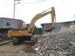 현대건설기계, 인도에 수해복구 굴삭기·성금 지원