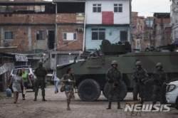 """브라질 리우 민병대조직 """"암처럼 자라나"""" 도시 장악"""
