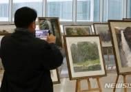 '통일의 봄은 오리라' 북한작가 그림 전시회