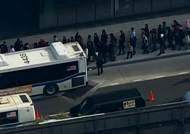 뉴욕에 웬 '콩나물 시루' 버스?…교통 마비시킨 '샌디'